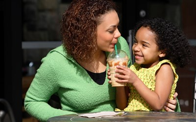 Foster mum sharing drink with child