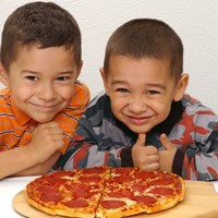 Children enjoying pizza