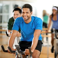 People cycling in the gym