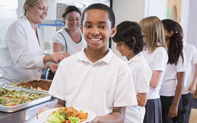 Young boy having school dinners