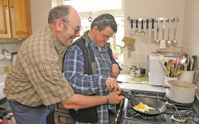 Shared Lives carer helping with cooking