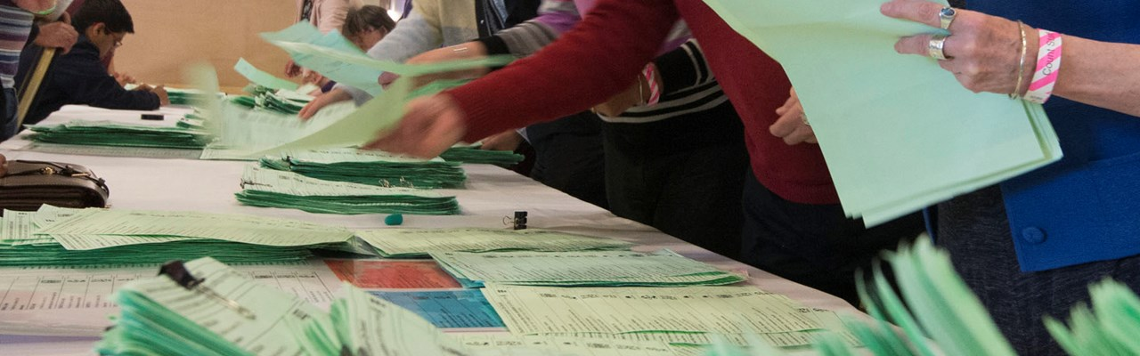 Image of voting papers being counted
