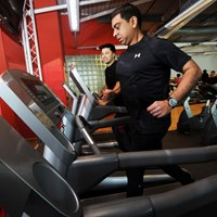 Men running on treadmills