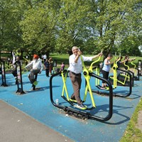 People using an outdoor gym
