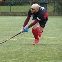 A dashing man playing hockey