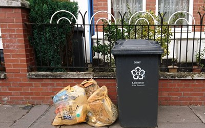 Orange bag and black bin on waste colleciton day