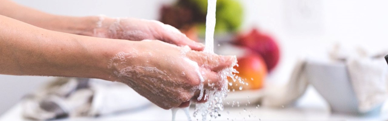 washing hands with soapy water