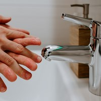 person hand washing