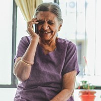 Elderly indian lady talking on the telephone